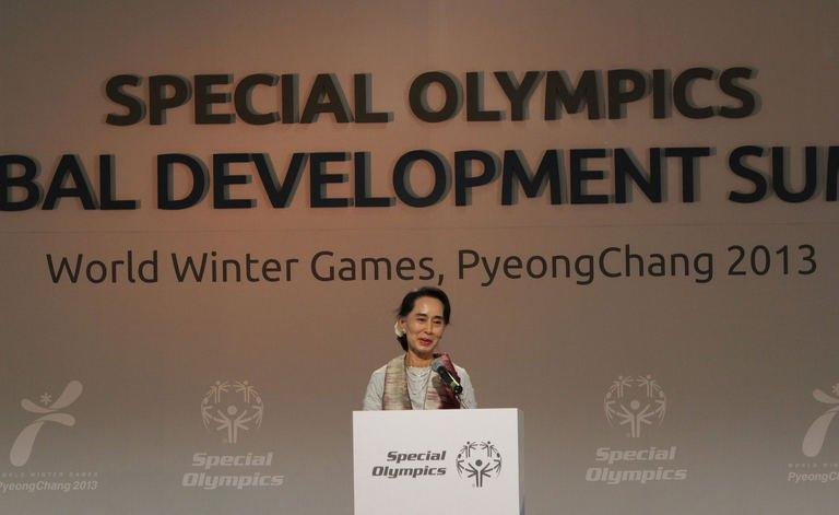 Myanmar's opposition leader, Aung San Suu Kyi talks to the media at The Global Development Summit, held on the sidelines of the 10th Special Olympics World Winter Games in Pyeongchang, on January 30, 2013. The democracy leader and Nobel peace laureate was a guest of honour at the opening of the Special Winter Olympics in the northeastern mountain resort of Pyeongchang