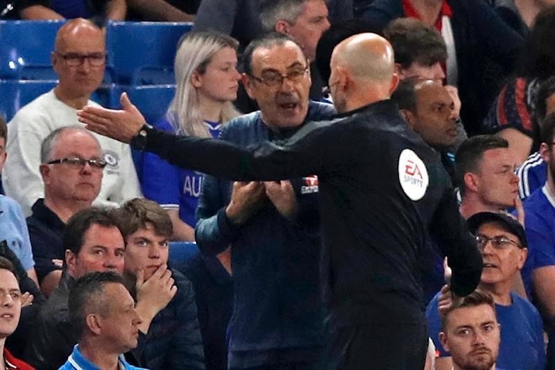 Chelsea manager Maurizio Sarri, pictured being directed away from the technical area by fourth official Roger East, was sent off against Burnley