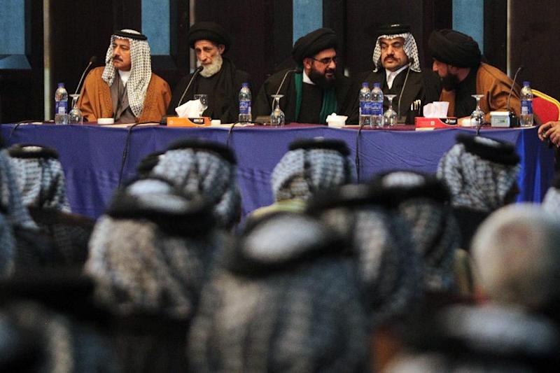 Shiite and Sunni tribal leaders and clerics speak on November 8, 2014 in Baghdad during a conference to discuss a support to Sunni tribes in their fight against the Islamist State group in Anbar province (AFP Photo/Ahmad al-Rubaye)