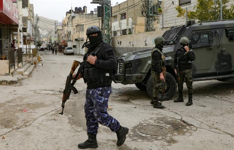 Palestinian security personnel maintain a heavy presence around Balata refugee camp in the Israeli-occupied West Bank, following an upsurge in intra-Palestinian violence