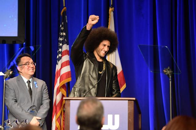 Colin Kaepernick raises his right first at the ACLU SoCal's annual Bill of Rights Dinner on Sunday in Beverly Hills. (Getty Images)