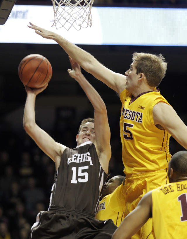 Lehigh guard Corey Schaefer (15) has his shot blocked by Minnesota center Elliott Eliason (55) during the first half of an NCAA college basketball game, Friday, Nov. 8, 2013, in Minneapolis. (AP Photo/Paul Battaglia)