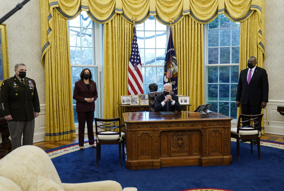 President Joe Biden meets with Secretary of Defense Lloyd Austin, right, Vice President Kamala Harris, and the Chairman of the Joint Chiefs of Staff Mark Milley, left, in the Oval Office of the White House, Monday, Jan. 25, 2021, in Washington. (AP Photo/Evan Vucci)