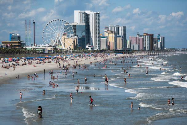 PHOTO: People wade in the surf in this file photo on May 23, 2020 in Myrtle Beach, S.C. (Sean Rayford/Getty Images, FILE)