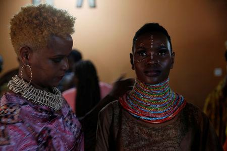 """A model receives final touches behind the scenes of a fashion show featuring African fashion and culture during a gala marking the launch of a book called """"African Twilight: The Vanishing Rituals and Ceremonies of the African Continent"""" at the African Heritage House in Nairobi, Kenya March 3, 2019.  REUTERS/Baz Ratner"""