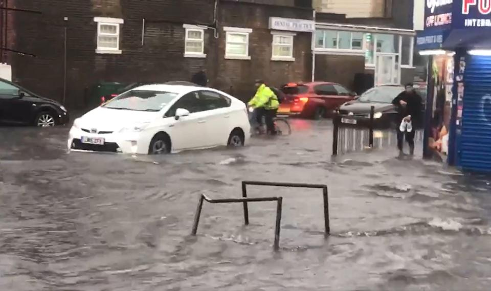 Flooded Turnpike Lane in north London (PA Media)