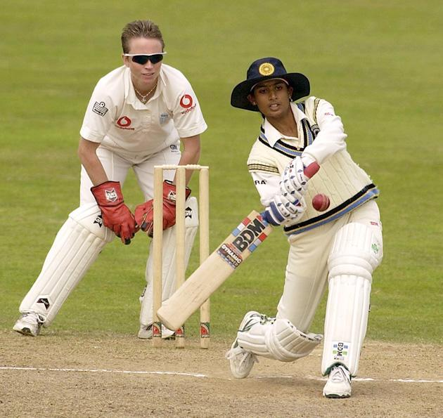 Mithali Raj of India hits out watched by England wicketkeeper Mandie Godliman during the Second Day of the Second Test Match between England and India played at The County Ground, Taunton on August 16, 2002. (Photo by Stu Forster/Getty Images)