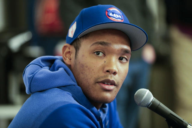 FILE - In this Friday, Feb. 15, 2019, file photo, Chicago Cubs shortstop Addison Russell speaks at a news conference after a spring training baseball workout in Mesa, Ariz. Russell is joining Triple-A Iowa to prepare for his return from a 40-game suspension for violating Major League Baseball's domestic violence policy. Russell is expected to play when Iowa begins a nine-game homestand Wednesday, April 24 against Nashville. (AP Photo/Morry Gash, File)