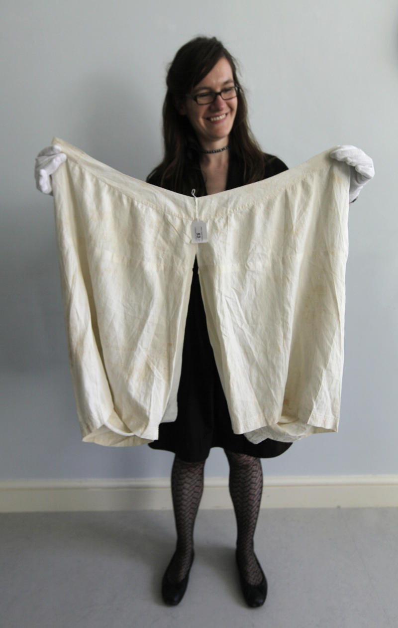 "Alexandra Kim, curator of the Royal Ceremonial Dress Collection, holds a pair of bloomers which once belonged to Britain's Queen Victoria, as she poses for the photographer at Kensington Palace, in central London, Tuesday, Sept. 8, 2009. The underwear, which has a 56-inch (142-centimeter) waist, has been added to Britain's Royal Ceremonial Dress Collection at Kensington Palace. It has a matching chemise, is embroidered with a ""VR"" and is believed to date from the 1890s. (AP Photo/Lefteris Pitarakis)"