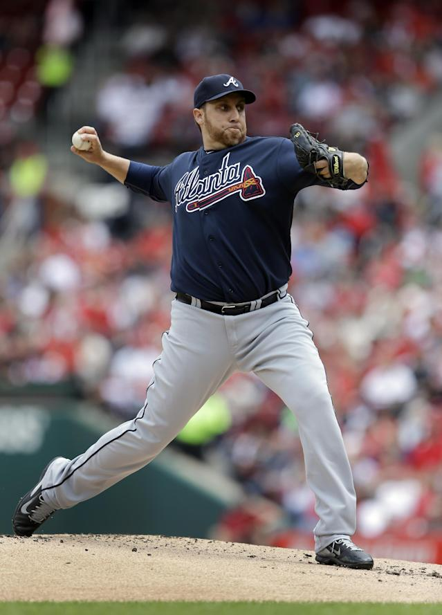 Atlanta Braves starting pitcher Aaron Harang throws against the St. Louis Cardinals during the first inning of a baseball game on Saturday, May 17, 2014, in St. Louis. (AP Photo/Jeff Roberson)