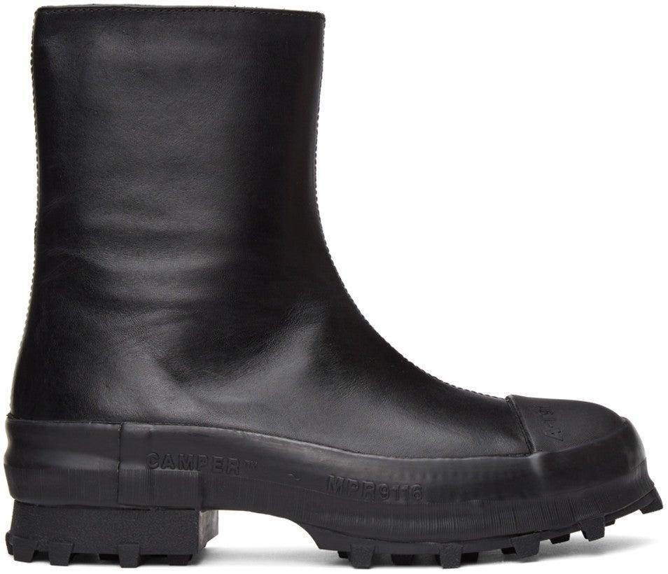 "<br><br><strong>CamperLab</strong> Black Traktori Boots, $, available at <a href=""https://go.skimresources.com/?id=30283X879131&url=https%3A%2F%2Fwww.ssense.com%2Fen-us%2Fwomen%2Fproduct%2Fcamperlab%2Fblack-traktori-boots%2F6057401"" rel=""nofollow noopener"" target=""_blank"" data-ylk=""slk:SSENSE"" class=""link rapid-noclick-resp"">SSENSE</a>"
