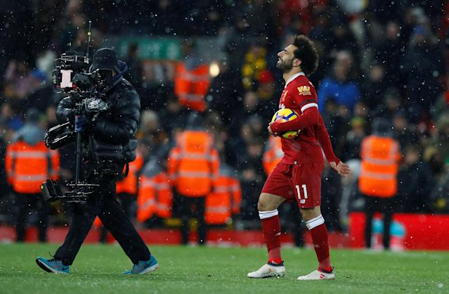 "Soccer Football - Premier League - Liverpool vs Watford - Anfield, Liverpool, Britain - March 17, 2018 Liverpool's Mohamed Salah with the matchball after the match REUTERS/Phil Noble EDITORIAL USE ONLY. No use with unauthorized audio, video, data, fixture lists, club/league logos or ""live"" services. Online in-match use limited to 75 images, no video emulation. No use in betting, games or single club/league/player publications. Please contact your account representative for further details."