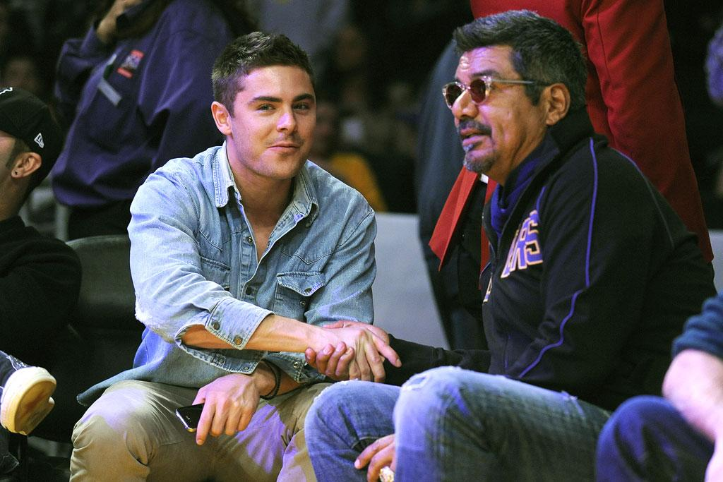 """Although it's unclear as to whether or not Zac Efron is indeed single, the actor kept a cheeky eye on the cheerleaders as he sat courtside with George Lopez at the L.A. Lakers vs. Boston Celtics game at the Staples Center in Los Angeles Sunday night. <a href=""""http://www.infdaily.com"""" target=""""new"""">INFDaily.com</a> - January 30, 2011"""