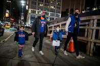 Fans arrive at Madison Square Garden to attend a Knicks game amid the coronavirus disease (COVID-19) pandemic in the Manhattan borough of New York City, New York
