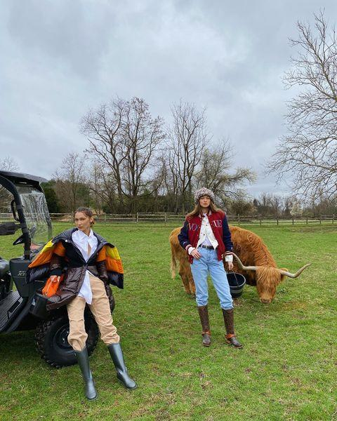"<p>For a lockdown shoot, Hadid posed with her sister in knee-high boots, high-waisted jeans, layered jackets and a furry hat at their mother's farm.</p><p><a href=""https://www.instagram.com/p/B_lAEFZnAYY/"" rel=""nofollow noopener"" target=""_blank"" data-ylk=""slk:See the original post on Instagram"" class=""link rapid-noclick-resp"">See the original post on Instagram</a></p>"