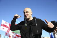Nika Melia, head of the United National Movement, gestures while speaking to Georgian opposition supporters of former president Mikheil Saakashvili during a rally in his support in front of the prison where former president is being held, in Rustavi, about 20 km from the capital Tbilisi, Georgia, Monday, Oct. 4, 2021. Saakashvili was detained in Tbilisi on Saturday, Oct. 1, 2021. Georgia earlier declared Saakashvili wanted as a person convicted in absentia in several criminal cases and treated as a suspect in some others. Georgian authorities have warned repeatedly that he would be detained immediately once over the border. (AP Photo/Zurab Tsertsvadze)