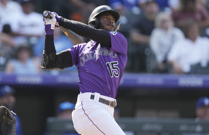 Colorado Rockies' Raimel Tapia follows the flight of his two-run home run off Los Angeles Dodgers starting pitcher Max Scherzer in the fifth inning of a baseball game Thursday, Sept. 23, 2021, in Denver. (AP Photo/David Zalubowski)