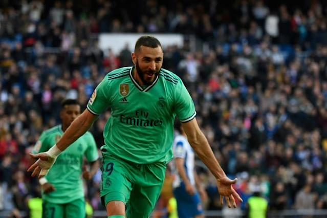 Karim Benzema scored his 15th goal of the season as Real Madrid beat Espanyol 2-0 on Saturday. (AFP Photo/PIERRE-PHILIPPE MARCOU)