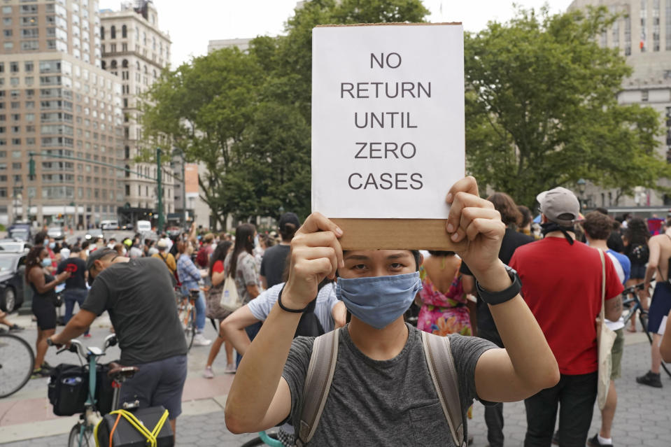 NEW YORK, UNITED STATES - 2020/08/03: A protester holds a placard that says No return until zero cases during the demonstration. (Photo by Ron Adar/SOPA Images/LightRocket via Getty Images)