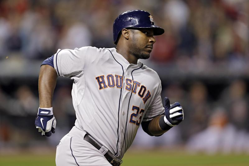 Houston Astros' Chris Carter rounds first after a solo home run off Cleveland Indians relief pitcher Joe Smith in the ninth inning of a baseball game Saturday, Sept. 21, 2013, in Cleveland. The Indians held on to win 4-1. (AP Photo/Mark Duncan)