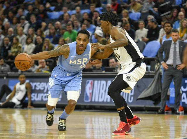 Minnesota Timberwolves guard Jeff Teague, left, drives past Los Angeles Clippers guard Terance Mann during the first half of an NBA basketball game Friday, Dec. 13, 2019, in Minneapolis. (AP Photo/Craig Lassig)
