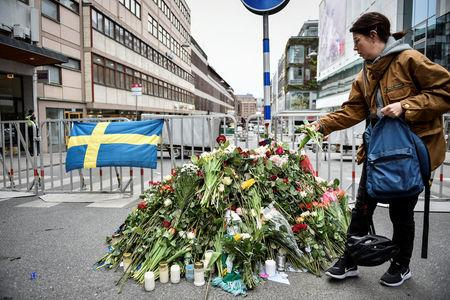 STOCKHOLM 2017-04-08 People gather at a police cordon near the crime scene in central Stockholm on April 08, 2017, the day after a hijacked beer truck plowed into pedestrians on Drottninggatan and crashed into Ahlens department store, killing four people, injuring 15 others. TT News Agency/Noella Johansson/via REUTERS