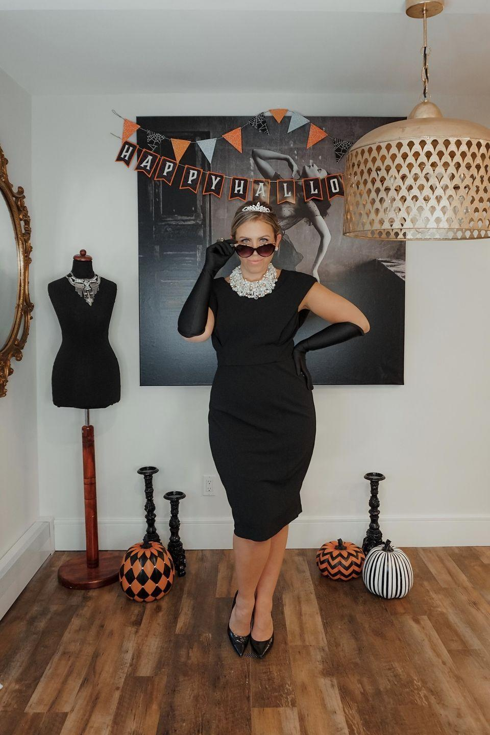 """<p>There's nothing more chic than dressing up as Holly Golightly from <em><a href=""""https://www.amazon.com/Breakfast-at-Tiffanys-Audrey-Hepburn/dp/B000HX499S?tag=syn-yahoo-20&ascsubtag=%5Bartid%7C10055.g.34292032%5Bsrc%7Cyahoo-us"""" rel=""""nofollow noopener"""" target=""""_blank"""" data-ylk=""""slk:Breakfast at Tiffany's"""" class=""""link rapid-noclick-resp"""">Breakfast at Tiffany's</a></em><em> — </em>or recreating her iconic <a href=""""https://www.goodhousekeeping.com/beauty/hair/tips/g1800/celebrity-hairstyles-updo/"""" rel=""""nofollow noopener"""" target=""""_blank"""" data-ylk=""""slk:updo hairstyle"""" class=""""link rapid-noclick-resp"""">updo hairstyle</a> from the movie. Not to mention, we love any excuse to wear a tiara and a classic LBD!<br></p><p><em><a href=""""http://livingaftermidnite.com/2020/10/iconic-movie-halloween-costumes-you-can-diy.html"""" rel=""""nofollow noopener"""" target=""""_blank"""" data-ylk=""""slk:Get the tutorial at Living After Midnite »"""" class=""""link rapid-noclick-resp"""">Get the tutorial at Living After Midnite »</a></em></p>"""