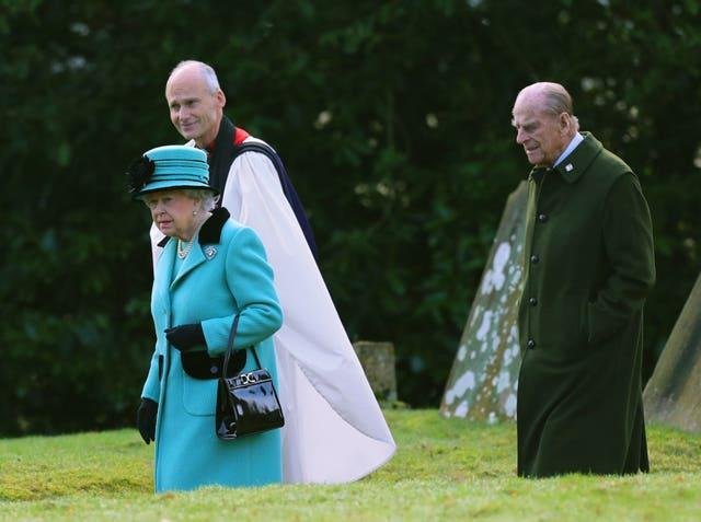 The Queen and the Duke of Edinburgh at St Peter and St Paul West Newton in Norfolk, as the Queen approached her Sapphire Jubilee