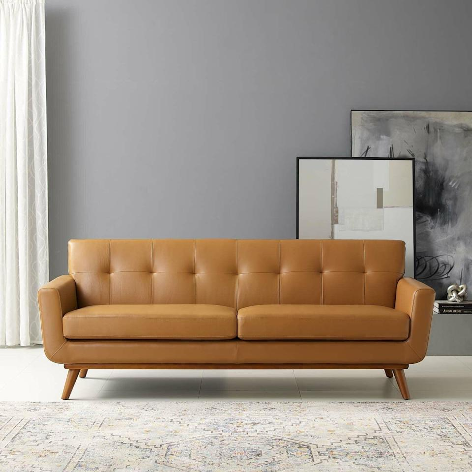 <p>This eye-catching <span>AllModern Acevedo Genuine Leather Square Arm Sofa</span> ($1,900, originally $3,651) is a unique piece that will add depth to your retro-modern living room.</p>