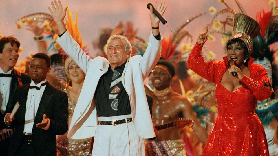 Mandatory Credit: Photo by Hans Deryk/AP/REX/Shutterstock (6528642a)Bennett LaBelle Benedetto Singers Tony Bennett and Patti LaBelle entertain the crowd during halftime at Super Bowl XXIX, at Miami's Joe Robbie StadiumSuper Bowl XXIX Half Time Show 1995, Miami, USA.