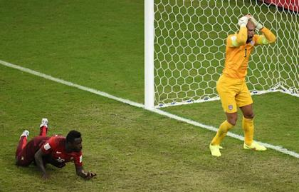 U.S. goalkeeper Tim Howard reacts to Silvestre Varela's equalizer in the 95th minute on Sunday. (AFP)
