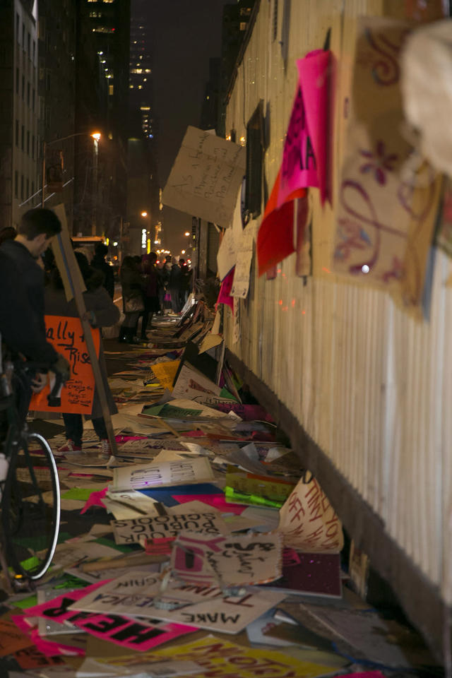 <p>People examine discarded signs on a trailer from Women's March in New York City on Jan. 21, 2017. (Photo: Gordon Donovan/Yahoo News) </p>