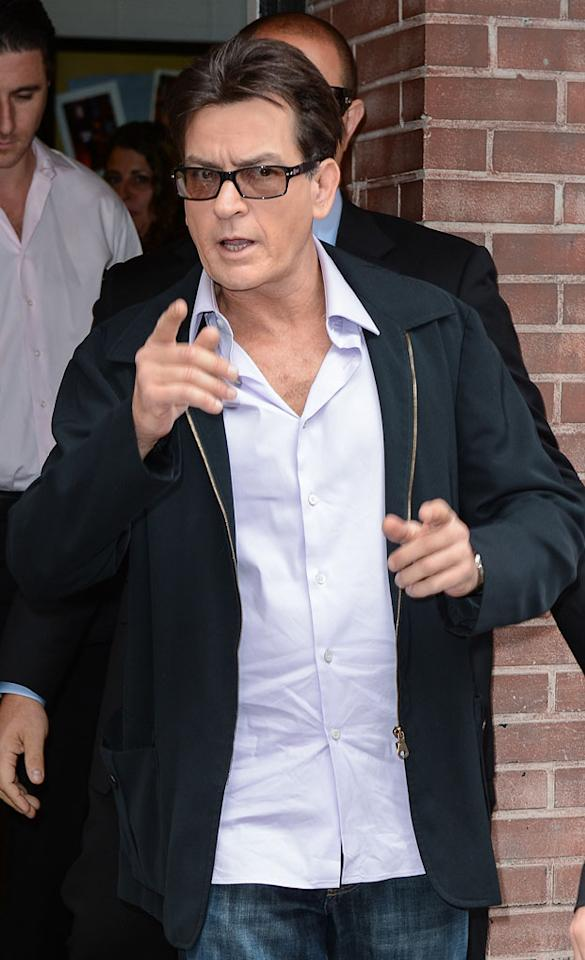 "Charlie Sheen ""trashed"" another hotel room while recently in New York with Denise Richards and their daughters, reports Us Weekly. The mag says Sheen threw a ""drug-fueled, weekend-long party at the Ritz with plenty of female escorts."" For the craziest part of the story, and whether he's banned by the hotel, see what Sheen and Ritz insiders leak to Gossip Cop."