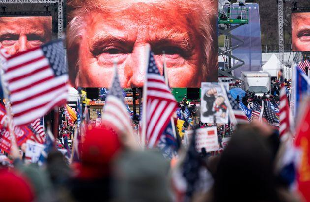 An image of President Donald Trump appears on video screens before his speech to supporters on Jan. 6 as the Congress prepared to certify the Electoral College votes. The U.S. Capitol riot began as his speech ended. (Photo: Bill Clark via Getty Images)