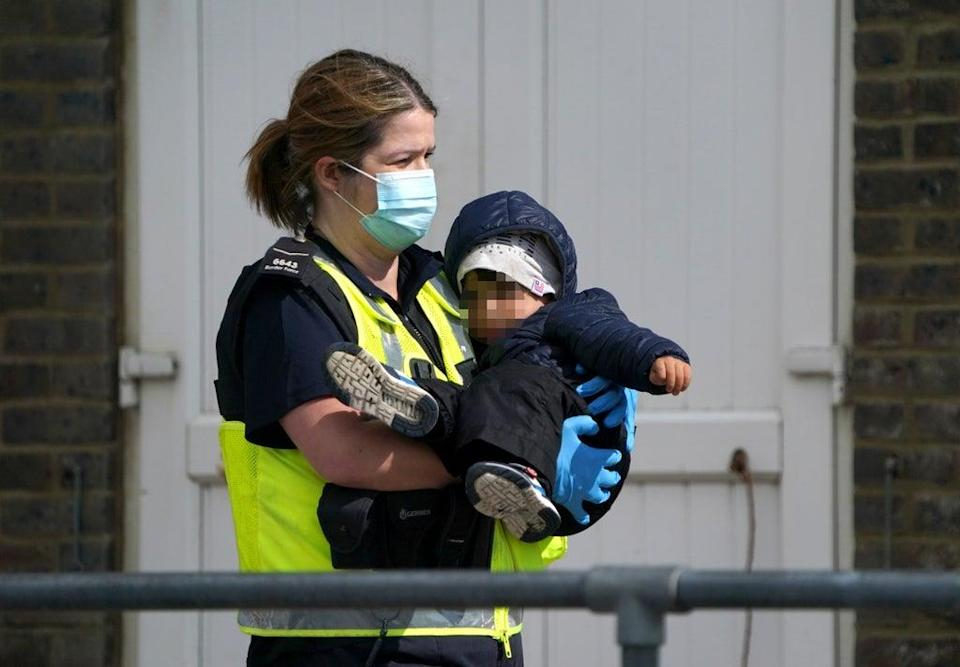 Crossings continued on Friday, with more young children among those being brought ashore in Kent (Gareth Fuller/PA) (PA Wire)