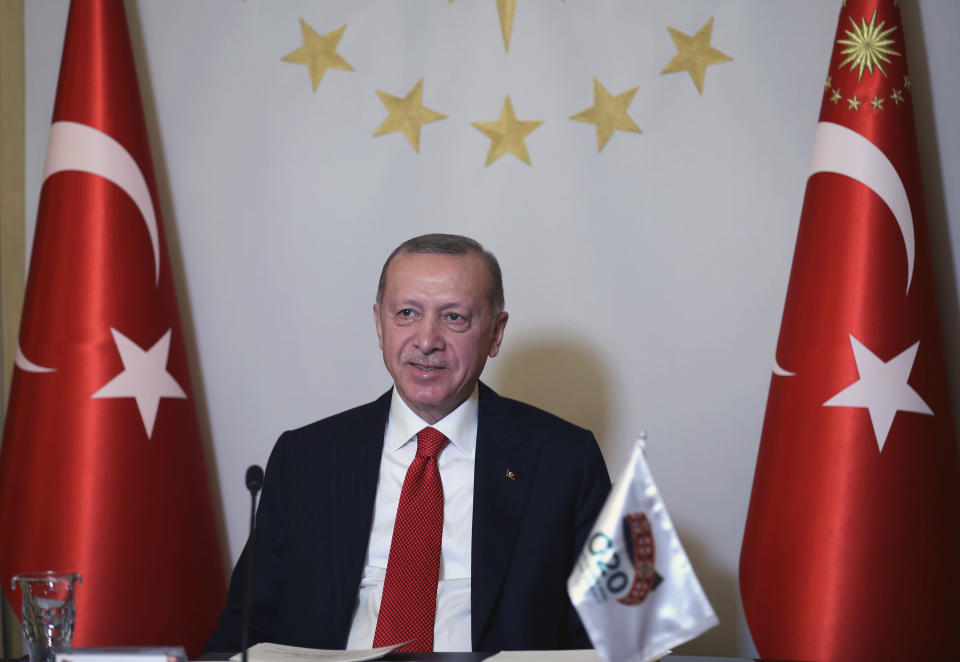 Turkey's President Recep Tayyip Erdogan addresses the leaders of the G20 Leaders' Summit with an introductory video message from his Vahdettin Pavilion, in Istanbul, Saturday, Nov. 21, 2020. Saudi Arabia is hosting the virtual meeting of G-20 leaders on Saturday and Sunday in line with coronavirus restrictions.(Turkish Presidency via AP, Pool)