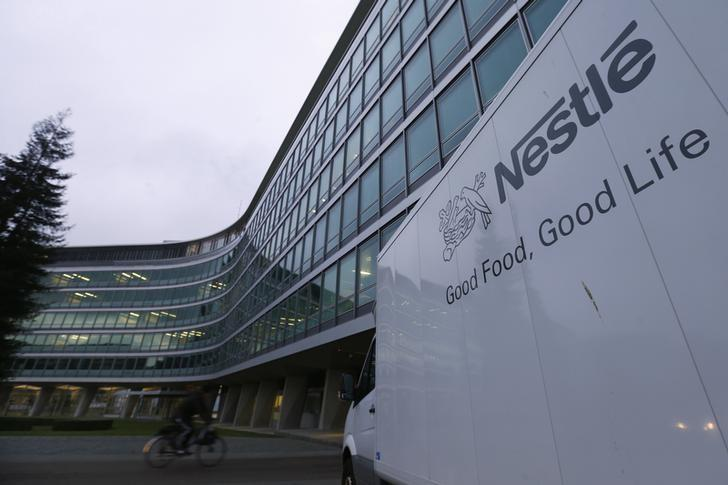 A Nestle logo is pictured on a van outside the company headquarters in Vevey