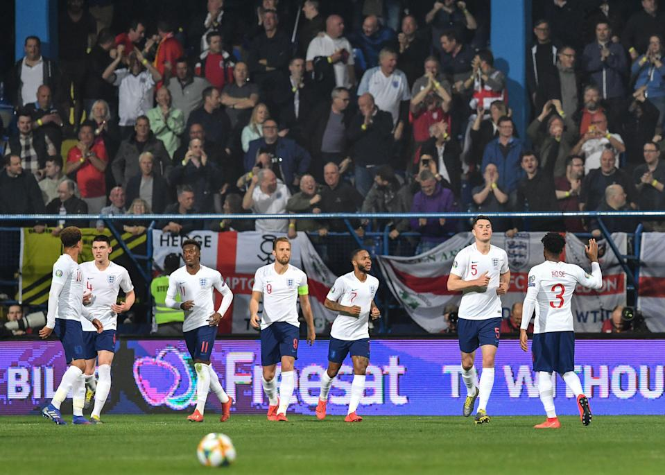England celebrate an emphatic victory over Montenegro