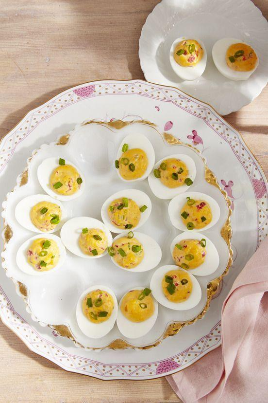 """<p>Is it even a country party without deviled eggs? Here, the classic """"caviar of the South"""" makes a perfect filling.</p><p><strong><a href=""""https://www.countryliving.com/food-drinks/a35912977/pimiento-cheese-deviled-eggs-recipe/"""" rel=""""nofollow noopener"""" target=""""_blank"""" data-ylk=""""slk:Get the recipe"""" class=""""link rapid-noclick-resp"""">Get the recipe</a>.</strong></p>"""