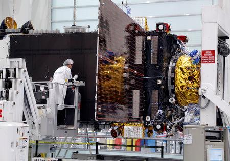 FILE PHOTO: Technicians work on the Inmarsat S-Band/Hellas-Sat 3 satellite in the clean room facilities of the Thales Alenia Space plant in Cannes