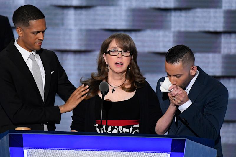 Christine Leinonen, center, mother of Christopher 'Drew' Leinonen, who was killed in the Pulse attack in Orlando, speaks as she is comforted by Brandon Wolf, left, and Jose Arraigada, right, both survivors of the attack, during the 2016 Democratic National Convention.