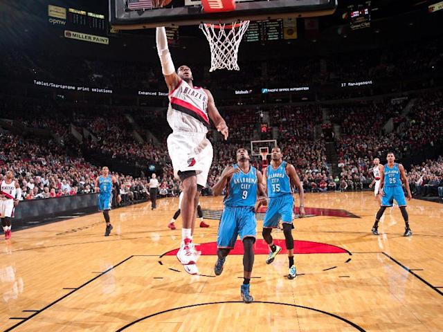 PORTLAND, OR - DECEMBER 4: LaMarcus Aldridge #12 of the Portland Trailblazers goes up for the dunk against the Oklahoma City Thunder on December 4, 2013 at the Moda Center Arena in Portland, Oregon. (Photo by Sam Forencich/NBAE via Getty Images)