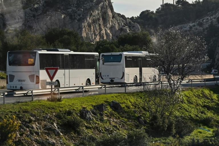 Buses took the evacuees to a holiday resort where they will be quarantined (AFP Photo/Hector RETAMAL)