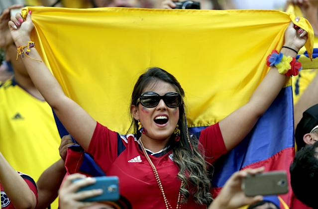 A Colombian supporter reacts during the group C World Cup soccer match between Colombia and Ivory Coast at the Estadio Nacional in Brasilia, Brazil, Thursday, June 19, 2014. (AP Photo/Marcio Jose Sanchez)