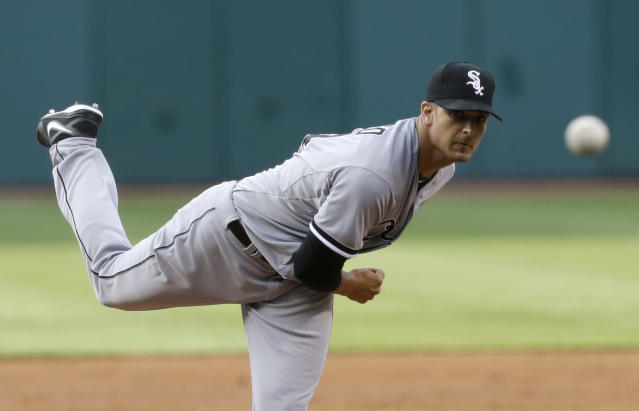 CORRECTS SPELLING OF LAST NAME TO RIENZO, NOT REINZO - Chicago White Sox's Andre Rienzo delivers in the first inning of a baseball game against the Cleveland Indians, Tuesday, July 30, 2013, in Cleveland. (AP Photo/Tony Dejak)
