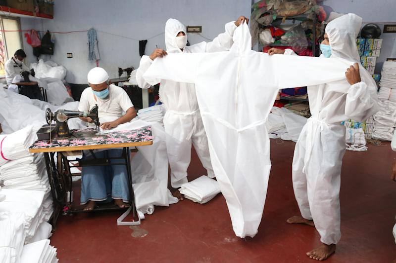 Indian Muslim Workers prepare personal protective equipment for medical staff at a workshop before their distribution to government hospitals during the countrywide 21 day lockdown amid concern over the spread of coronavirus, in Near Kolkata on April 5, 2020.A nationwide lockdown announced by Prime Minister Narendra Modi led to a mass exodus of migrant workers from cities to their villages, raising fears that the virus may have reached to the countryside, where health care facilities are limited. Experts say that local spreading is inevitable in a country where tens of millions of people live in dense urban areas with irregular access to clean water. (Photo by Debajyoti Chakraborty/NurPhoto via Getty Images)