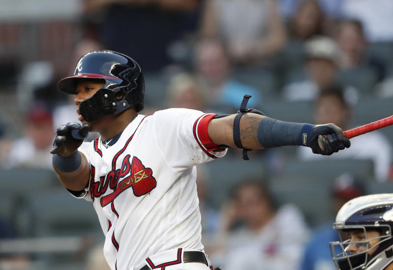 Atlanta Braves' Ronald Acuna Jr. follows through on a single in the first inning of a baseball game against the Colorado Rockies on Thursday, Aug. 16, 2018, in Atlanta. (AP Photo/John Bazemore)