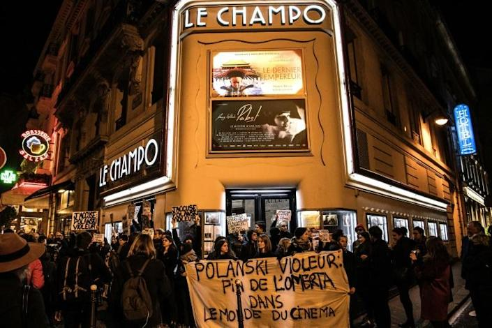 """Protesters on Tuesday blocked the entrance to a cinema in Paris showing Polanski's new film, """"An Officer and a Spy"""" (AFP Photo/Christophe ARCHAMBAULT)"""