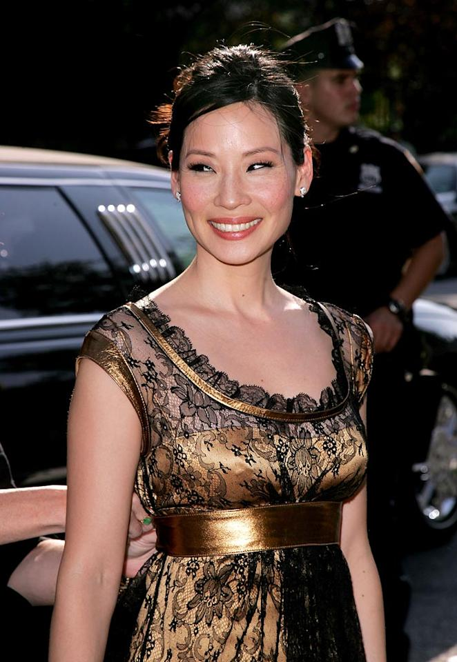 "Lucy Liu is probably wondering if she overdressed for this daytime event. James Devaney/<a href=""http://www.wireimage.com"" target=""new"">WireImage.com</a> - May 15, 2007"