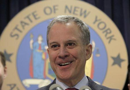 FILE PHOTO: New York Attorney General Eric Schneiderman speaks during a news conference in New York March 21, 2016. REUTERS/Brendan McDermid/File Photo